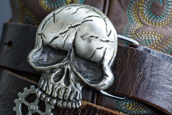 Close up skull buckle on Boot JuJu boot strap