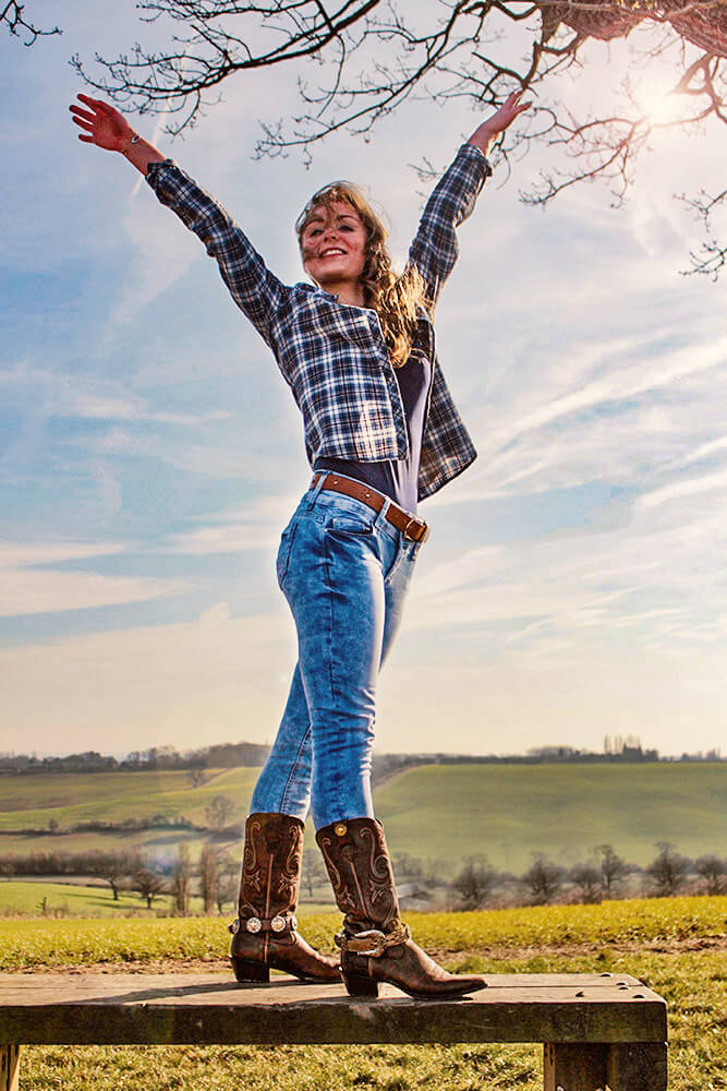 Model wearing Boot JuJu in countryside