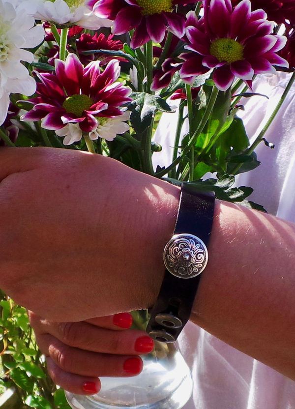 leather bracelet on girl with flowers