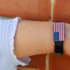 American flag jewellery on girls arm