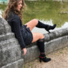 Girl with leg up on wall