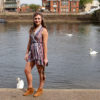 girl near river in boots
